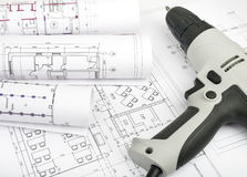 Architecture plan and rolls of blueprints Royalty Free Stock Images