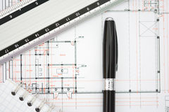 Architecture plans of a building with blueprints, ruler and notebook. Architecture plans of a building with blueprints, pen, ruler and notebook stock image