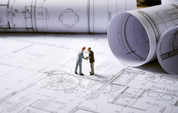 Architecture plans with character Royalty Free Stock Photos