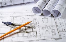 Architecture plans with compass. Architecture plans and sketch of house project with compass Royalty Free Stock Photo