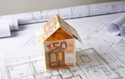 Architecture plans with money house Stock Images
