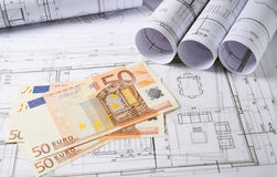 Architecture plans with money royalty free stock photo