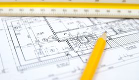 Architecture plans of some building. With tools Stock Photos