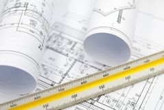 Architecture plans of some building. With tools Royalty Free Stock Photo