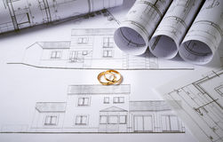 Architecture plans with wedding rings stock photo
