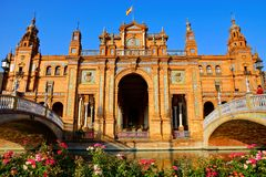 Architecture of Plaza de Espana with flowers, Sevilla, Spain Royalty Free Stock Image