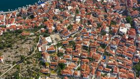 Architecture of Porose island in Greece. tiled roofs of the old European city. Aerial video footage. View from above stock video footage