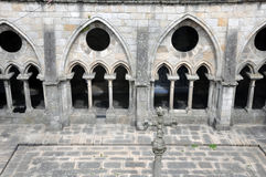 Architecture of Porto Cathedral. Architectural detail of the Cathedral in Porto , Portugal showing Romanesque arches and stone flagged courtyard Royalty Free Stock Image