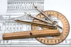 Project architecture with an old historic plan and useful tools. royalty free illustration