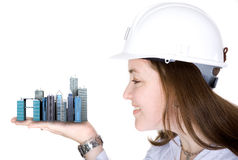 Architecture project - woman holding buildings Stock Photography