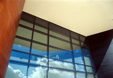 Architecture reflecting sky and clouds.