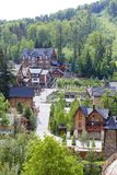 Architecture of the resort town of Migovo in the Carpathian Mountains, Ukraine. Concept of ecological tourism Stock Image