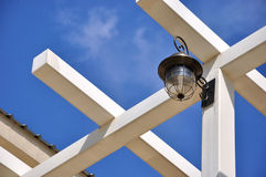 Architecture roof and frame with lamp. With blue sky background, shown as beautiful color and featured shape or composition from construction Royalty Free Stock Photo