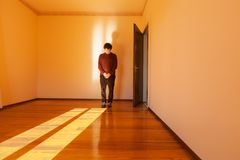 Man prays in front empty room royalty free stock images