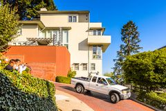 Architecture of San Francisco, USA. SAN FRANCISCO, USA - OCT 5, 2015: Famous wavy Lombard street on Russian hill in San Francisco. SF is the cultural, commercial Royalty Free Stock Photos