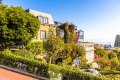 Architecture of San Francisco, USA. SAN FRANCISCO, USA - OCT 5, 2015: Famous wavy Lombard street on Russian hill in San Francisco. SF is the cultural, commercial Royalty Free Stock Photography