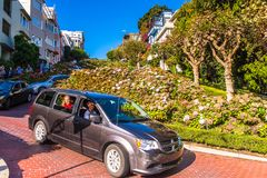 Architecture of San Francisco, USA. SAN FRANCISCO, USA - OCT 5, 2015: Famous wavy Lombard street on Russian hill in San Francisco. SF is the cultural, commercial Royalty Free Stock Images