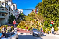 Architecture of San Francisco, USA. SAN FRANCISCO, USA - OCT 5, 2015: Famous wavy Lombard street on Russian hill in San Francisco. SF is the cultural, commercial Stock Image