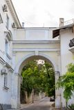 Architecture of Sevastopol. Old courtyard and arch on a summer day.  Royalty Free Stock Images