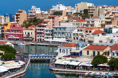 Architecture of a small harbor at Aghios Nikolaos town on Crete island, Greece Royalty Free Stock Photo
