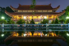 Architecture temple at night when lights flickered as glorified spiritual beauty. Royalty Free Stock Image