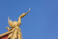 Architecture on the temple Thai gable roof against blue sky back Stock Photos
