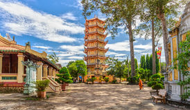 Architecture temple tower in Binh Duong. Binh Duong, Vietnam - November 7th, 2014: beauty architecture tower temple with the temple go into the large yard and stock photography