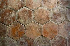 Architecture texture -flooring. Old distressed floor tiles.Six sided shape Royalty Free Stock Photos