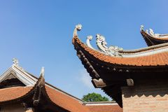 Architecture of top roof of Imperial Academy on fifth courtyard in Temple of Literature or Van Mieu in Hanoi, Vietnam.  Royalty Free Stock Images