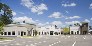 Architecture variety strip mall. An empty mixed architectural style commercial mall Royalty Free Stock Image