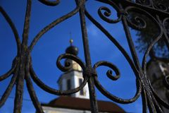 Architecture of Vladimir town, Russia. Old church seen through metallic gates. stock images