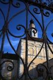Architecture of Vladimir town, Russia. Old church seen through metallic gates. stock photo