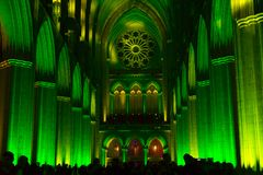 Architecture of Washington National Cathedral illuminated by lights. WASHINGTON, DC - FEBRUARY 5, 2018: `Seeing Deeper` - Space, Light and Sound event at Stock Images