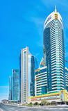 Architecture of West Bay, Doha, Qatar. DOHA, QATAR - FEBRUARY 13, 2018: Outstanding modern architecture of office buildings and hotels in Al Corniche street of Royalty Free Stock Photos