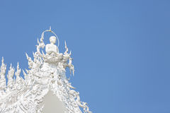 Architecture  of white buddha statue on the temple Thai roof agai Stock Photos