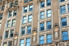 Architecture and windows. Looking upward at a wall of windows with decorative architectural design Royalty Free Stock Images