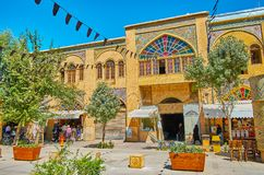 Architecture of Zand street, Shiraz, Iran. SHIRAZ, IRAN - OCTOBER 14, 2017: Historical architecture of Zand street with covered market, decorated with portals stock image