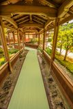 Zen Temple Arashiyama. Architecture of Zen Temple Tenryu-ji in Arashiyama in the mountains on western outskirts of Kyoto, Japan. The long covered corridor leads Royalty Free Stock Image