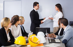 Architecturer making a deal Royalty Free Stock Photo