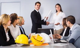Architecturer making a deal Royalty Free Stock Images