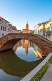 Architectures and canals of Comacchio. Italy, Comacchio , a canal in the country center with the Clock Tower un the background Stock Photos