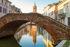 Architectures and canals of Comacchio. Italy, Comacchio , a canal in the country center with the Clock Tower un the background Royalty Free Stock Photography