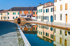 Architectures and canals of Comacchio. Italy, Comacchio, houses on the San Pietro canal Royalty Free Stock Photo