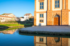 Architectures and canals of Comacchio. Italy, Comacchio, the old St Camillo hospital on the Via Nuova canal Stock Image