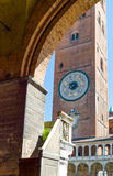 The architectures of Cremona. Italy, Cremona, Duomo Square, the Torrazzo basement seen from the Town Hall arcade Stock Image