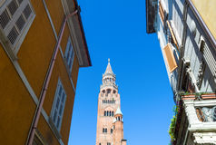 The architectures of Cremona. Italy, Cremona, view from the old town of the `Torrazzo`, the cathedral bell tower Royalty Free Stock Photo