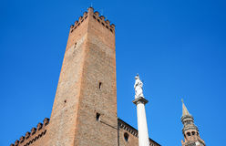 The architectures of Cremona. Italy, Cremona, view of the town center towers and Della Pace column Royalty Free Stock Photos