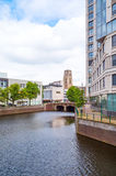 The architectures and landscapes of Rotterdam. Rotterdam, The Nederlands, a canal of the city center with the San Lorenzo bell tower in the background Stock Photography