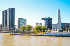 The architectures and landscapes of Rotterdam. Rotterdam, The Nederlands - July 18, 2016: Modern architectures on the Maas river bank Royalty Free Stock Photos
