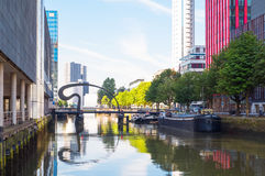 The architectures and landscapes of Rotterdam. Rotterdam, The Nederlands - July 18, 2016: Modern architectures in the Wijnhaven canal area with the Ibis bridge Royalty Free Stock Image